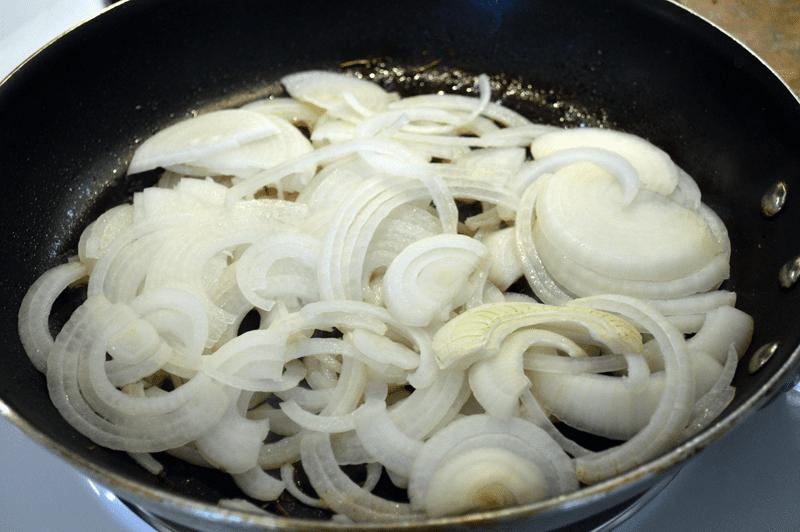 grannie geek add sliced onions to medium hot skillet