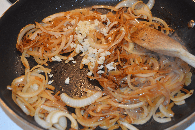 grannie geek add chopped garlic to the caramelized onions